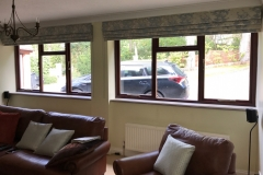 Roman blinds and coordinating piped cushions in Ashley Wilde Elstow collection
