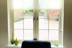 Upholstered window pelmet board in Mistral fabric with voile roller blind