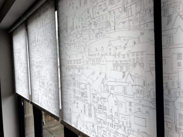 Blinds with pictures of housing on them