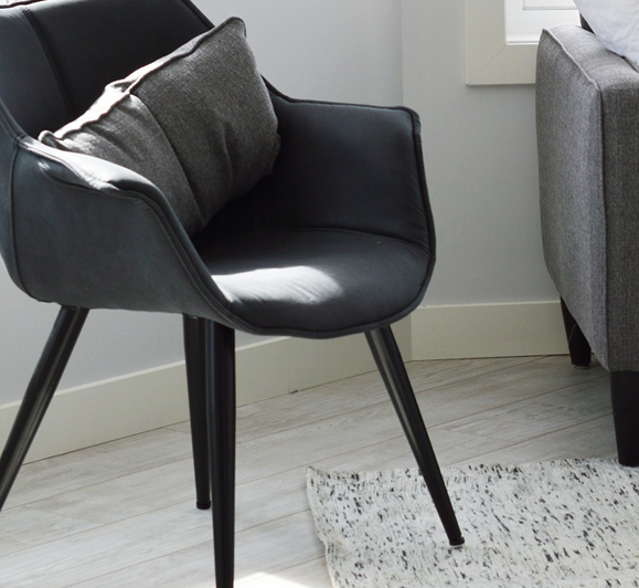 white wooden flooring with chair and rug on top for flooring Service Image