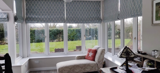 grey and white patterned blinds in the conservatory