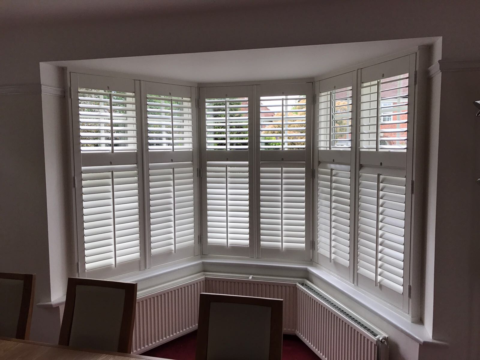 Wooden blinds over windows