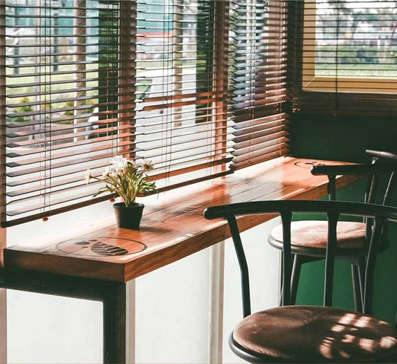 beautiful blinds in study by desk for blinds service page