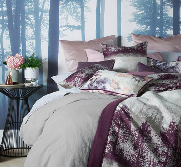 Messy bed with forest background