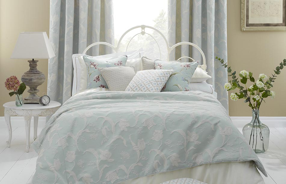 Bed with lots of floral pillows