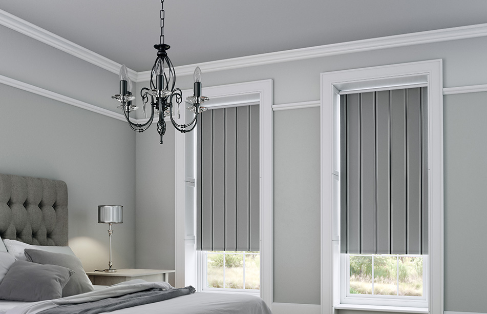 Grey roller blinds in a grey bedroom