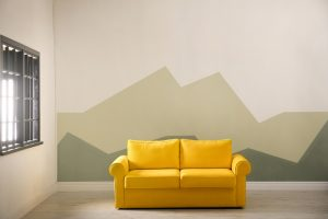 Yellow sofa interior design feature