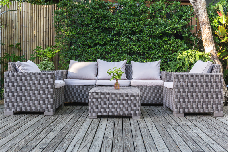 rattan furniture on wooden decking